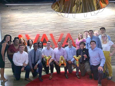Large group photo of Avaya team members
