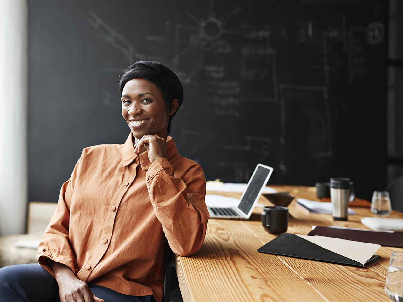 Woman smiling and working on a computer
