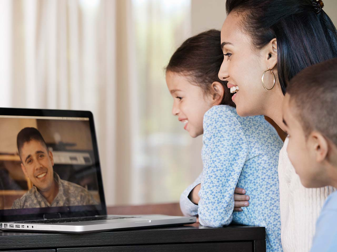 Family having video chat with military father