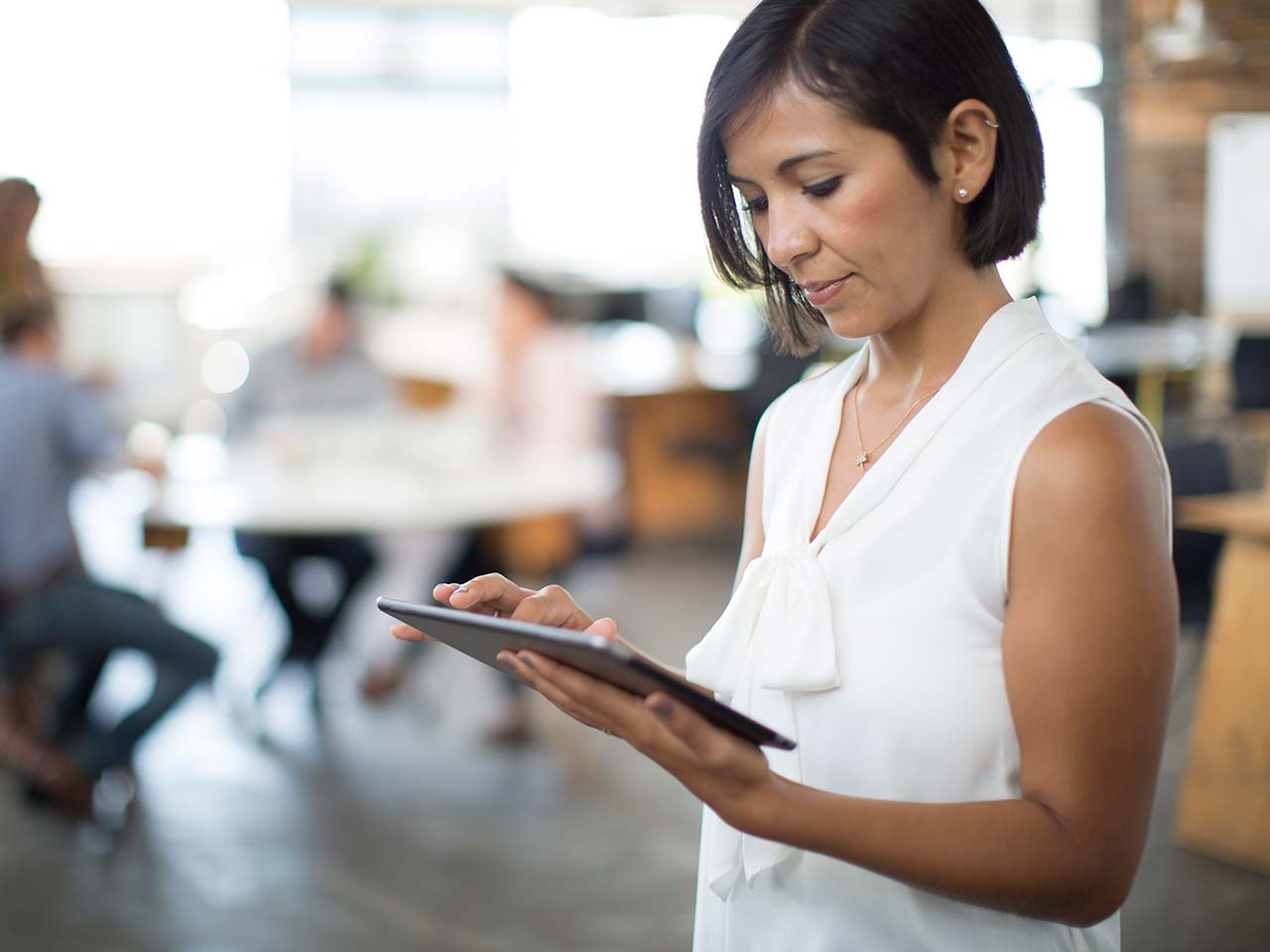 Woman scrolling on a tablet