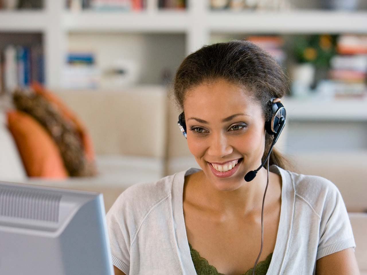 Female working from home with headset on.